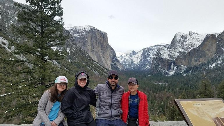 Dr. Christopher Lukasik and family by the mountains