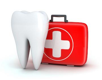 tooth next to a first aid kit