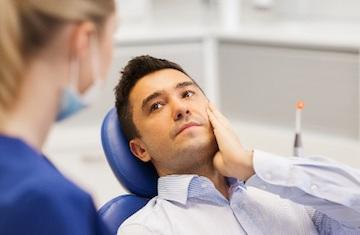 Man at emergency dentist appointment in Merrillville IN