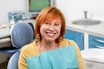 Woman smiling at dentist appointment in Merrillville
